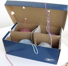 For using multiple balls of yarn, find an old shoe box and added internal dividers cut out of old cardboard. Then poke a hole in the lid of the box over each compartment, feeding the yarn through.  Just had to share this inexpensive, great idea!!