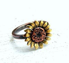 Brass and copper handmade sunflower ring. I use a jewelers saw to cut the shape of the sunflower from copper and brass sheet which I soldered onto Cute Jewelry, Jewelry Box, Jewelry Rings, Jewelry Accessories, Jewlery, Silver Jewelry, Gold Jewellery, Bridal Jewelry, Silver Rings