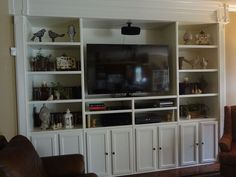 Cabinets from Lowe's were combined with beadboard & shelving to build this custom entertainment center.