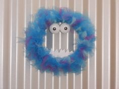 Check out this item in my Etsy shop https://www.etsy.com/listing/476558121/monster-wreath