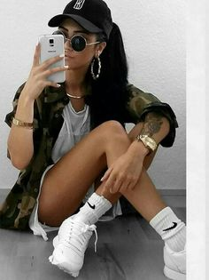 (Warm & 50/50) Girly Tomboy // Black hat, Black Shades, Gold Jewelry (hoops, watch, bracelet, necklace), Light Grey Top (or romper), Camouflage Jacket, White Sneakers (with white socks)