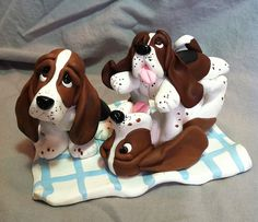 They are bassets (basset hound picnic) but with small changes would go for spaniels :-)