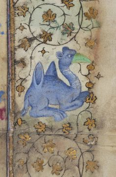 "Book of Hours, MS M.919 fol. 4r - Images from Medieval and Renaissance Manuscripts - The Morgan Library & Museum. | A ""fantastic creature"" is painted into the margin on this leaf -- what does it look like to you?"