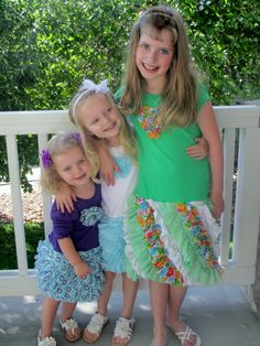 Emilia, Adeline, and Claire in their FLUFFY RUFFLES dresses made by Grandma Katie.  So cute!