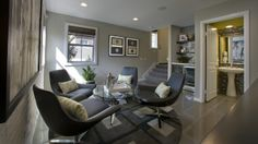 Family room at Bungalow 7 by Taylor Morrison