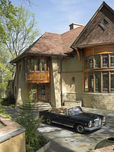 traditional exterior by Archer & Buchanan Architecture, Ltd.; bow window and circle bay window