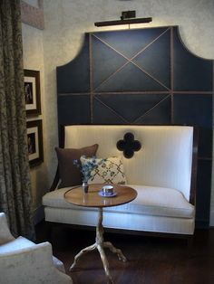 love the shape (and nailheads) on this upholstered wall, hiding behind the settee.  (basement?)