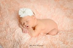Newborn baby girl studio session. Newborn inspiration for baby pictures with hand made hats, headbands, and diaper covers. Newborn picture ideas. Image by Kari Bruck Photography