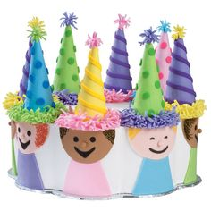 Festive fondant figures clad in equally festive fondant T-shirts crowd around a 12 in. x 2 in. Petal Pan cake. Make happy-day hats by covering sugar cones with vibrant fondants.