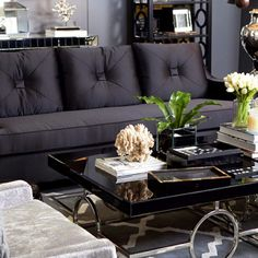 Lovely dark furniture against perfect gray.