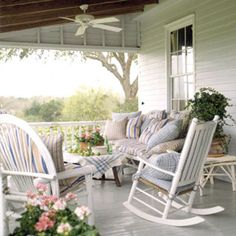 Classic Country BRING COMFORT TO THE PORCH: Take your living room outdoors this summer with a comfortably furnished porch. A classic rocking chair, plenty of pillows, and verdant views welcome lazy conversations on a summer afternoon. A ceiling fan helps keep the porch cool all summer long.