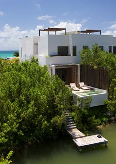 Each of the 128 suites at this gorgeous, high-design resort offers a private plunge pool, a rooftop sundeck, and an individual boat dock. Families can play beach volleyball and soccer on the sugar-soft sands, haul Hobie Cats and snorkeling gear out to sea, or enlist in kids' club activities. (The concierge can also book guided excursions to a nearby Mayan Sacred Cenote or underwater cave.) Grown-ups will want to find time to slip away to Sense Spa, with its steam grottoes, treatment rooms…