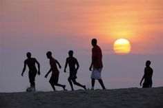 Angolan youths play soccer on the beach in the capital Luanda January 26, 2010.  REUTERS-Mike Hutchings