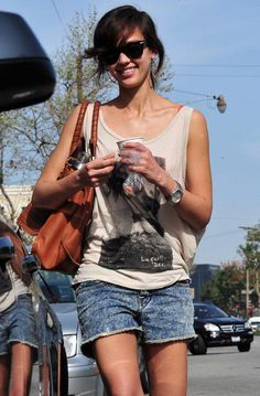 i love the tank style t-shirt! i also love the faded shorts and the brown bag completes the outfit! overall, a perfect outfit for summer/spring!