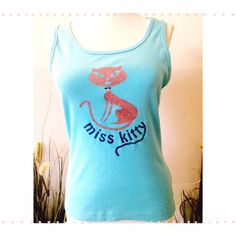 """Vtg Tank top Aqua tank with glittery design. Miss Kitty has stones for eyes & a metal diamond collar tag. 17"""" bust, 20"""" length juniors large, but fits like a small eyeshadow Tops Tank Tops"""