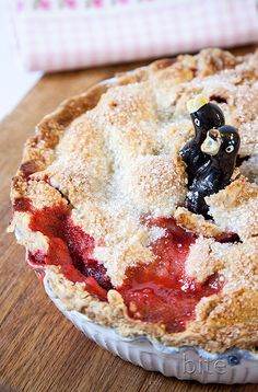 strawberry rhubarb pie - summer on a plate! (The ceramic pie bird lets out the steam in the pie as it cooks.)