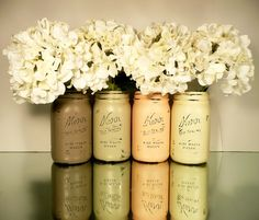 Painted mason jars. Wrap lip below mouth with a little bit of straw and use as centerpieces or to decorate food tables etc.
