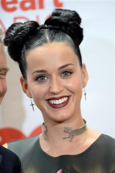 #KatyPerry rocks a dark #maroon #color on her #lips. See more celebs on Wonderwall: http://on-msn.com/1e77x6d