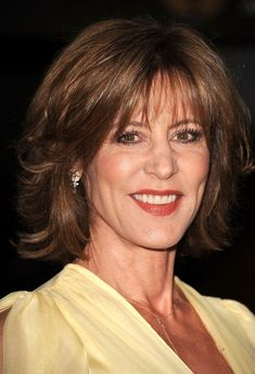 Like your style with a bit more bounce and body? A shoulder-skimming, medium-length hairstyle with layers like Christine Lahti has gives you more face-framing fullness (perfect for women over 50 whose facers have gotten thinner with age.)