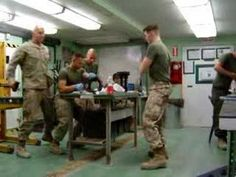 "How to have a good laugh: Watch these soldiers have a good time-- ""Your Tax Dollars At Work (I'm in the blue gloves)"" Cha Cha Slide I Love To Laugh, Make Me Smile, Blue Gloves, Military Humor, I Salute You, Funny Signs, Just For Laughs, Funny Photos, The Funny"