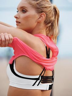 You KNOW the workout's getting serious when the shirt comes off.  | Angel by Victoria's Secret Strappy-Back Sport Bra