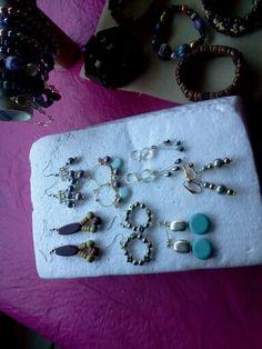 Some of tbe earrings
