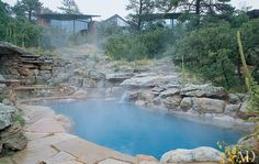 At a Castle Rock, Colorado, residence, landscape architect Rosa Finsley built the pool into a swale and augmented the existing stone outcroppings with granite boulders. The quarrylike environment fits perfectly with the home's Rocky Mountain location. (June 2001)