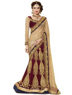 Enchanting maroon and golden color lehenga saree. Item Code: SUL2411