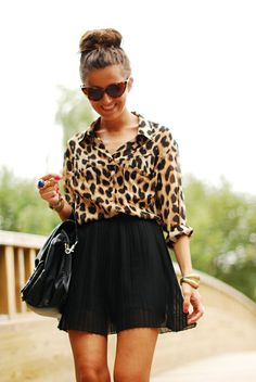 leopard shirt, short pleated skirt, big black bag, Cat's eye sunglasses, and big bold blue ring!