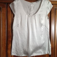 LOFT Sleeveless Silver Silk Top - Large This silver toned top would look great dressed up or down.  It's made of 100% Silk.  It's on the smaller side of large and could almost be listed as medium. LOFT Tops Blouses
