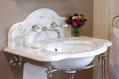 La parisienne single arabascato marble basin with splash back and wall mounted basin taps