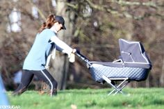 Duchess and Prince of Cambridge with Lupo in Kensington Gardens, London