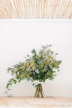 Bridal bouquet with only greenery. No flower bouquet. Bridal bouquet without flowers