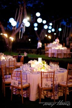 Garlands and pendant style lanterns hanging from trees at Hoku Amphitheater