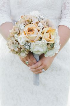 Rose and broach wedding bouquet.
