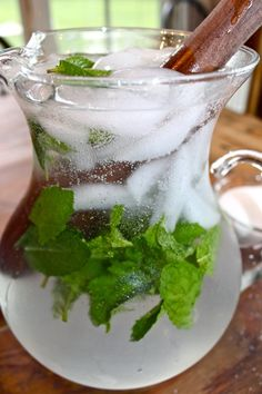 Sparkiling Cojito: 1 bunch fresh mint, keep a few sprigs to the side for garnish 1/2 cup sugar 3 tablespoons water 4 limes juiced 3 cups coconut rum, like Blue Chair Bay 1 liter seltzer water Ice Lime wedges for garnish