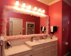 Love the feather design on the mirror for phoems bathroom.
