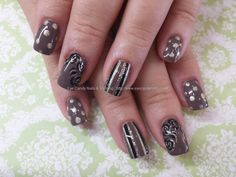 Legend polish with gold and black stripes and roses
