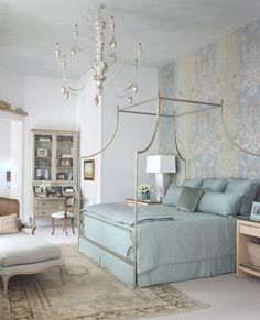 Dreamy blue bedroom. Cute chandelier, bed, and colors.