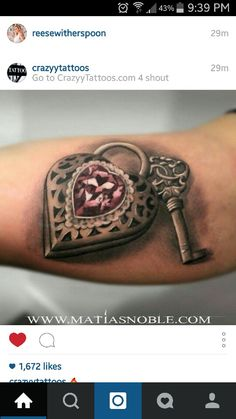 Key and locket tattoo