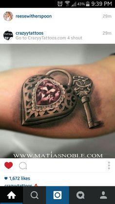 Key and locket tattoo
