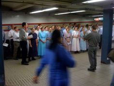 Mennonites singing to straphangers at the Broadway stop, NYC.