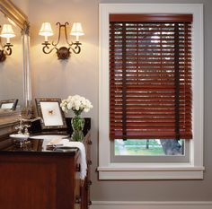 dark wood blinds with tape