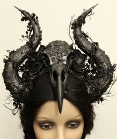 Image 3- I wanted to some how work into a darker theme, and have these horn like structured incorporated into the makeup look in some way.