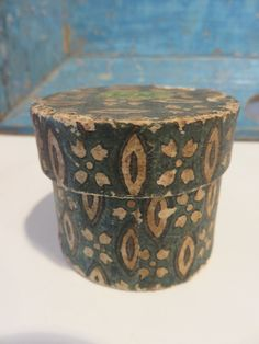 """Ebay: Signed & dated 1834 2"""" wallpaper covered box with hair memorial."""