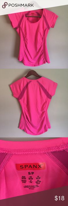 Spanx | Women's Active Top Size small, hot pink women's athletic top. Underarm/back ventilation mesh, figure flattering ruching and ruffle detail. Spandex blend. Machine washable. Measurements in photos. These are no longer in production! SPANX Tops Tees - Short Sleeve