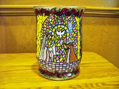This candle jar depicts scenes from the storybook The Princess and the Kiss hand painted on a recycled glass jar, and sealed with a lacquer