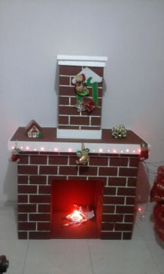 como hacer chimeneas navideñas en carton - Buscar con Google Christmas Fireplace, Faux Fireplace, Christmas Candle, Christmas Lights, Office Christmas, Christmas Door, Christmas Crafts, Fruit Crafts, Cardboard Fireplace