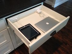 Wire your drawers. Do you need your technology while you cook, perhaps to look up recipes or cooking hints, make cooking notes, play music or make diary entries? A powered drawer can keep your electronics off the counter and away from cooking mess and moisture and can charge them at the same time.