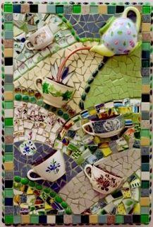 mosaic panel with tea pot and tea cups .